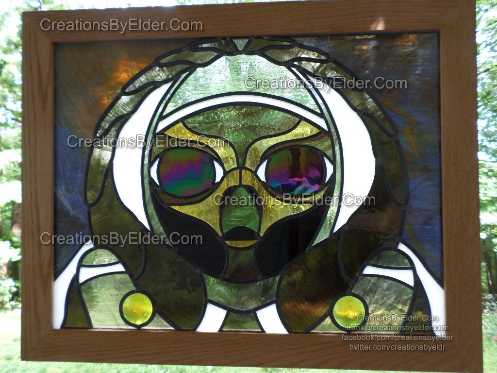 alien astronaut stained glass panel leaded art